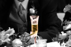 Grooms toast. The grooms champange toast glass Royalty Free Stock Image