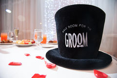 Grooms top hat on table Stock Photography