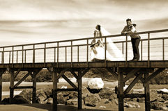 Grooms walking on the beach Royalty Free Stock Photography