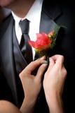 Grooms wedding flower stock images