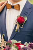 Grooms with wooden bow-tie and red rose boutonniere on wedding. Day Stock Image