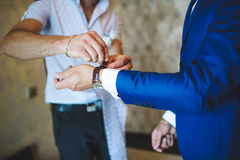 Groomsman Clasping Watch Royalty Free Stock Image