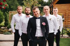 Stylish groomsman with groom standing on the backyard and prepare for the wedding ceremony. Friend spend time together. Groomsman with groom standing on the stock image