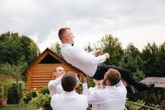 Stylish groomsman with groom standing on the backyard and prepare for the wedding ceremony. Friend spend time together. Groomsman with groom standing on the stock images