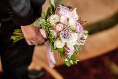 Groomsman hold in hand jne bouquets for bridesmaids stock image