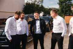 Groomsman spend time with groom at the backyard. Guys laugh and have fun.  stock images