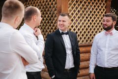 Groomsman spend time with groom at the backyard. Guys laugh and have fun.  royalty free stock image