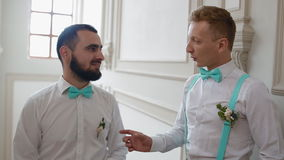 Groomsman talking and laughing with groom stock video footage