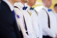 Groomsmen during catholic wedding ceremony Stock Images