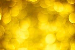 Groot bokeh gouden onduidelijk beeld Gouden schitterende lichten Massieve bokehcirkels stock foto's