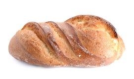Groot die brood op witte achtergrond wordt geplaatst Royalty-vrije Stock Afbeelding