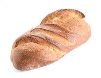 Groot die brood op witte achtergrond wordt geplaatst Royalty-vrije Stock Foto's