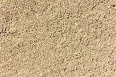 Groot Gouden zand van het overzees, de oppervlakte van de overzeese kust, textuur, achtergrond stock fotografie