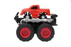 Groot vrachtwagenstuk speelgoed met grote die wielen, bigfoot, monstervrachtwagen op witte achtergrond wordt geïsoleerd Royalty-vrije Stock Foto's
