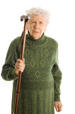 Grootmoeder die een riet op witte achtergrond houdt stock foto's