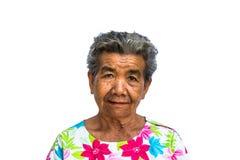 Grootmoeder die zich met geïsoleerde witte achtergrond bevinden Stock Foto