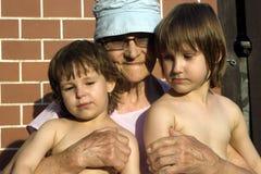 Grootmoeder en grandchilds Stock Foto
