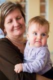 Grootmoeder met baby   royalty-vrije stock afbeelding
