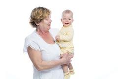 Grootmoeder met baby Stock Foto's