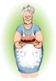 Grootmoeder met een pastei Royalty-vrije Stock Afbeeldingen