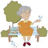 Grootmoeder op de bank voedende vogels Royalty-vrije Stock Afbeeldingen