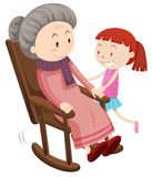 Grootmoeder op de schommelstoel en het meisje Royalty-vrije Stock Fotografie