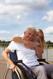 Grootmoeder in rolstoel Stock Foto's