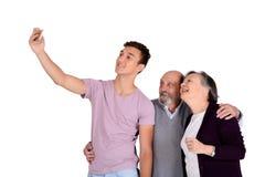 Grootouders en hun kleinzoon die een selfie nemen royalty-vrije stock afbeelding