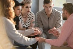 Grooup of teenagers with psychotherapist stock photography