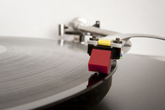 In the Groove. Analogue record player arm in close-up Stock Image