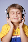 Groove. Listening to fave music Royalty Free Stock Image