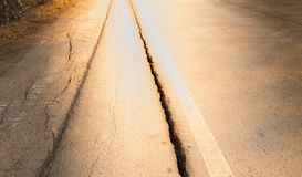 Groove of road damage Potentially dangerous for motorcyclists royalty free stock photography