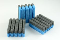 Grooved Grill sponges. Grooved sponges for leaning non stick grill without scratching surface on white background Stock Image