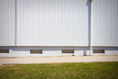 Grooved metal wall. White industrial grooved metal wall Stock Image