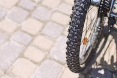 Grooved tire on a mountain bike wheel on a sunny day. Grooved black tire on a mountain bike wheel on a sunny day royalty free stock images