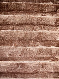 Grooved wood texture of a fence outside. Close up detail of a wooden fence Royalty Free Stock Images