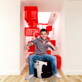 Groovy. Happy young man in a surreal decor Stock Images