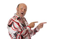 Groovy Man Excited. A man in seventies ear pointing to the side with a positive jubilant expression. Add own text Royalty Free Stock Photography