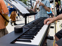 Groovy playing piano at outdoor fest Royalty Free Stock Image