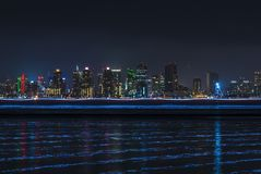 Groovy San Diego skyline at night with light trails over water stock images