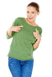 Groovy trendy young woman. Laughing and gyrating her body pointing her fingers  isolated on white Royalty Free Stock Photos