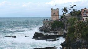 Gropallo tower storm sea cliff storm waves crash on the rocks Genova Nervi Liguria Italy stock video footage