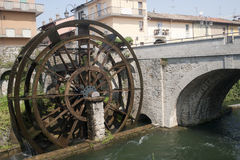 Groppello d'Adda, ancient wheel. Groppello d'Adda (Milan, Lombardy, Italy), ancient bridge and watermill in a sunny summer morning royalty free stock image