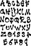 Gros alphabet liquide de police et de nombre au-dessus de blanc Photographie stock