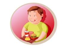 Gros enfant affamé avec la nourriture industrielle Photographie stock libre de droits