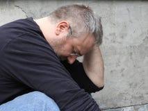 Gros mâle et tristesse photo libre de droits