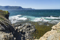 Gros Morne Coastline. The blue-green waters of the Gulf of St. Lawrence off the cliffs of Lobster Cove Head in Gros Morne National Park, Newfoundland Stock Image