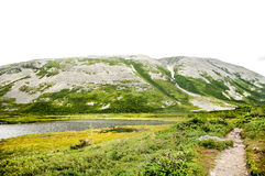 Gros Morne Mountain. Hike up Gros Morne and step on rocks risen from the earth`s mantle Stock Photography