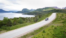 Gros Morne National Park, Newfoundland, Canada. Motorhome on a mountain road at Gros Morne National Park, Newfoundland, Canada.  Tablelands in the background Stock Image