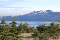 Gros Morne Park, Newfoundland, Canada. A view of the fog rolling into a bay in Gros Morne National Park (a Unesco site), Newfoundland, Canada stock photo